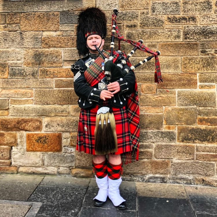 Bagpiper on the best tours of Scotland by Every Road a Story